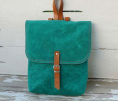 Green Canvas Mini Backpack, perfect for dancing around at a concert!