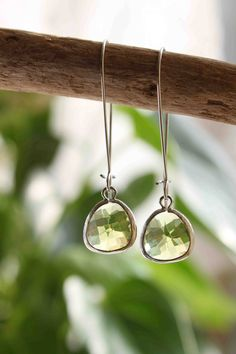 Peridot. Stunning Rhodium plated peridot green stone dangle earrings. $28.00, via Etsy.