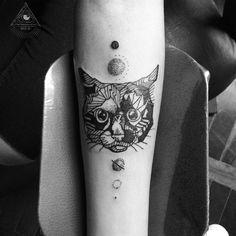 Geometric cat tattoo, black work. Art by Broken Ink Tattoo
