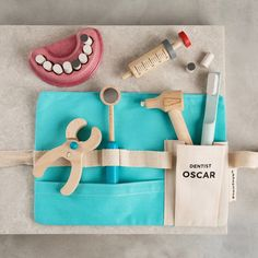 This fun personalised toy is a must-have for young Dentists! The tool belt and wooden instruments with toy teeth are perfect for make-believe! Each toy includes 4 basic dental tools, 1 toothbrush, 1 . Toddler Toys, Baby Toys, Kids Toys, Diy Sensory Board, Tool Belt, Wooden Diy, Handmade Wooden Toys, Wood Toys, Kids Playing