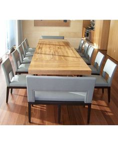 Custom extendable dinning table love the big 2 seater bench on the end!