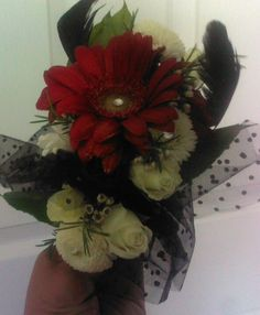 Fresh flower Prom corsage. Using Red Gerber daisy, mini red & white Roses & white pom mums, white wax flowers.