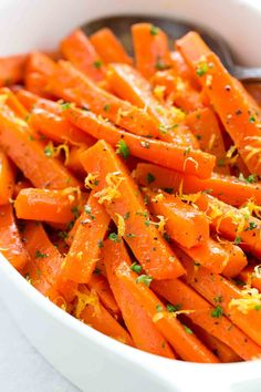Photo of glazed carrots in a white serving bowl