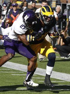 Michigan's Jake Butt  drags Northwestern's Matthew