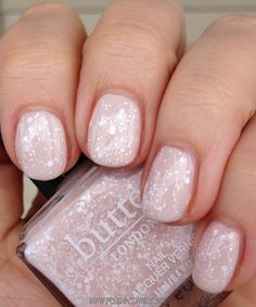 Doily is a sheer overcoat filled with white matte bar glitter and different sizes of hex glitter.