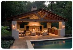 Like this idea for a nonenclosed pool house.  Don't need a fireplace, but would do a nice fire pit for roasting marshmallows.  Add ceiling fans.