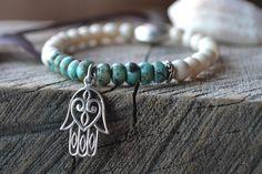 A personal favorite from my Etsy shop https://www.etsy.com/listing/278309730/yoga-bracelet-hamsa-bracelet-yoga