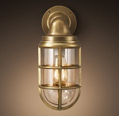 "Starboard Sconce Antique Brass   Forged from aluminum and brass Clear glass enclosure Heavy-duty cage protects the bulb Professionally stripped and finished Uses one 40W max. Type A equivalent bulb (included) Wet UL listed: suitable for use indoors or outdoors, including areas that receive direct contact with rain, snow or excessive moisture  Small: 5¾""L x 4¾""W x 11""H; 6 lbs. Large: 6¾""L x 5½""W x 13¾""H; 7.8 lbs."