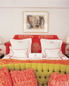 JENNIFER CREEL'S BEDROOM    With the help from her designer sister, Suzanne Coleman Bancroft, Jennifer Creel created a mix of bright textiles in her energetic Manhattan master bedroom. The bed features a headboard upholstered in an Osborne & Little fabric and crisp red-trimmed sheets by Leontine Linens. The charcoal drawing is by Robert De Niro Sr.