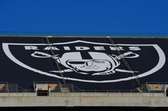OAKLAND, CA - NOVEMBER 09:  A detailed view of the tarp displaying the Oakland Raiders logo that covers mount Davis seen prior to the game against the Denver Broncos at O.co Coliseum on November 9, 2014 in Oakland, California.  (Photo by Thearon W. Henderson/Getty Images)