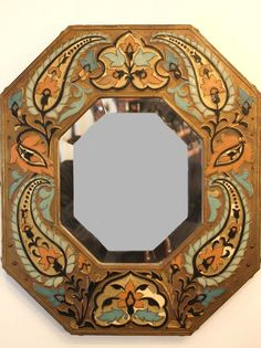 Beveled #mirror in a frame of octagonal form, in partitioned #enamel polychrome decorated with foliage. Early #20th century. For sale on #Proantic by La Malle d'Elisa.