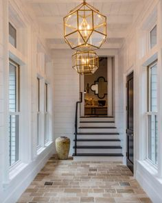 Modern meets traditional in this inviting Lowcountry river house Traditional Style Homes, Modern Traditional, River House Decor, Master Suite Addition, Master Suite Layout, Palmetto Bluff, Entry Hallway, Entryway, Brick Flooring