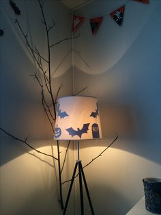 All you need for this is a similar type of lamp, paper, scissors and tape. And a little bit of imagination!