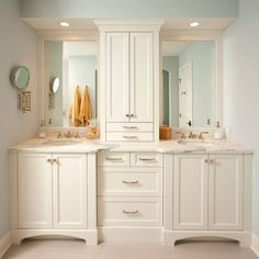 Bathroom idea. Love all the cabinets especially separating the 2 sinks.