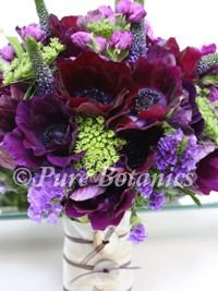 Purple wedding bouquet with anenomes