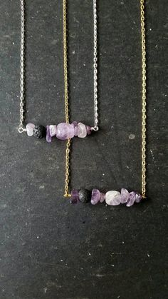 》》ORIGINAL AuraStrands design《 《 Unique essential oil diffuser necklace featuring a row of amethyst stones and an off-center lava rock bead on which