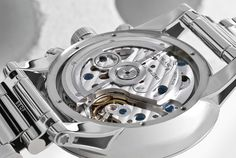 Six screws secure the caseback, which has a sapphire window.