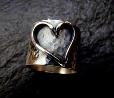 This is a 1.5 cm ( 5/8) inch solid sterling silver statement rustic ring with a heart design hand sawn from 2mm fine silver wire The ring bang has