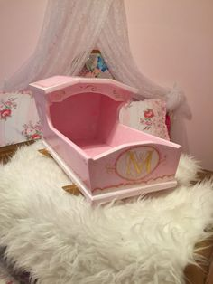 Hand-painted wooden doll cradle. Fits 19 inch dolls. Check out my blog: http://blog.paintedheartmarket.com/2016/02/a-treasure-not-a-toy/