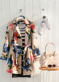 Nothing says spring like a bright floral print. Take the trend one step further with an exceptional trench coat from ELLE. The combination of over-sized blooms and black trim adds an unexpected twist to a traditional style. Featured product includes: ELLE trench, Converse sneakers and Apt. 9 satchel. Get the right spring mix at Kohl's.