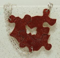 Puzzle Piece Interlocking Necklaces Red by GirlwithaFrogTattoo