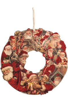 "This charming wreath is made of cut wood and features nostalgic Santa Claus imagery. It adds a festive and pretty look to any wall or door and looks as fresh year after year as it did the first season you put it out. Made by Primitives by Kathy this wreath measures 16"" across. Santa Wood Wreath by Primitives by Kathy. Home & Gifts - Home Decor - Holiday Boulder Colorado"