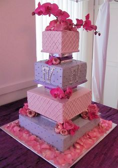Tiered square wedding cake with phalaenopsis orchids & roses accenting the clean Victorian design.
