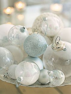 """Add some sparkle to your tabletop. Tableware designer Rosanna Bowles puts her prettiest ornaments where people can really see them. """"I display my favorites on a vintage tray,"""" she says. More holiday party tips »"""