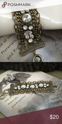 """Edgy antique gold and rhinestone bracelet Different chains and rhinestones connected together to make a 2 1/2"""" wide band. 7"""" long to first ring. Jewelry Bracelets"""