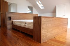 SQ1 Walnut bed, integrated remote TV lift cabinet & Tree bookcase bed head with Burr walnut drawer box detail integrated bedside comparts