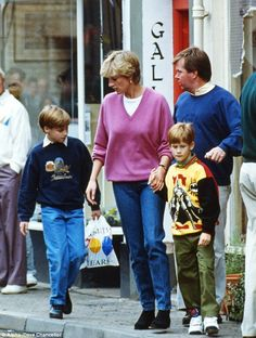 Princess Diana and her boys Princes William and Harry, out and about at the shops, with Ken Wharfe, their security officer looking around to ensure their safety. Diana wearing jeans and a V neck pink sweater.
