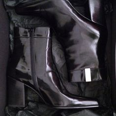 Prada Black Boots Prada boots in sleek silhouette and above the ankle but below the calf height. Black polished leather with brushed nickel signature Prada hardware, stack heel in black, inside zipper and full leather interior. Excellent condition, gently worn once for an indoor event. % Authentic with Original box & tag. Prada Shoes Ankle Boots & Booties
