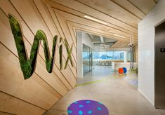 Take a tour of the offices in Miami Beach – design by Stantec: osna. Corporate Office Design, Office Wall Design, Office Mural, Office Logo, Office Entrance, Corporate Interiors, Entrance Design, Workplace Design, Office Interior Design