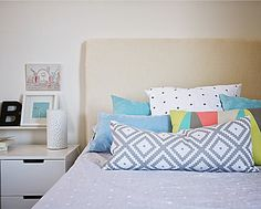 Pastel pillows are just what your bedroom needs for spring.
