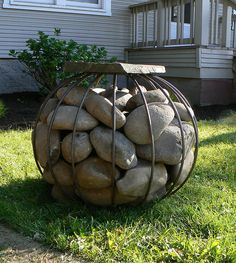 River rock stool~gabion  In a play area for children to study, imagine or estimate stone weight, positioning and the spaces in between.