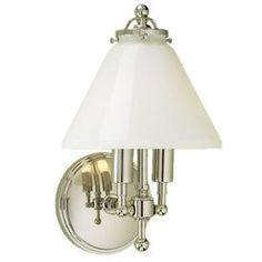 "Two-light wall sconce with a shiny opal glass bell shade and polished nickel finish. Crafted of brass.Product: Wall sconceConstruction Material: Metal and glassColor: Polished nickelAccommodates: (2) 60 Watt incandescent Edison base bulb - not includedDimensions: 11.5"" H x 7.5"" W"