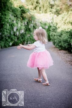 Little girl catching bubbles at this family session at Baxter Gardens in Fountain City by Knoxville Wedding Photographer, Amanda May Photos