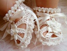 Baby booties with ribbon and pearls