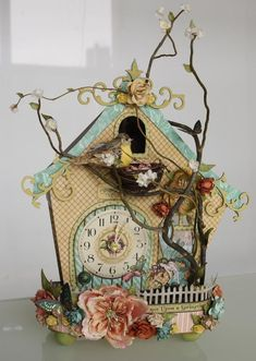 Lovely floral birdhouse clock with a bird on a branch ... tan with an aqua roof ... love it (LauraDenison01)