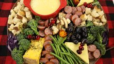 A winter fondue board with cranberries, broccoli, turkey sausage, and cheese Fondue, Purple Cabbage, Broccoli Florets, Turkey Sausage, Blue Cheese, Bite Size, Fruits And Vegetables, Meals