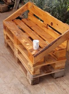 """Love, love, love, this stacked palled bench.  Again, this looks to be pallets cut in thirds for the stack and """"seat"""" portions of the bench and some harvested slatting for the sides and back rest.  This little """"sofa""""  kinda goes perfectly w/those cinder block """"shelves!"""""""