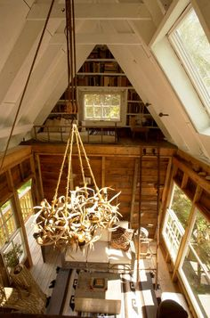 antler chandelier and one of the two sleeping lofts in the treehouse cottage, Camp Wandawega, Elkhorn WI Adult Tree House, Antler Chandelier, Cabin Chandelier, Tree House Designs, Apartment Therapy, My Dream Home, House Tours, Future House, Home Design