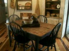 black table and chairs in white farmhouse setting primitive dining. beautiful ideas. Home Design Ideas