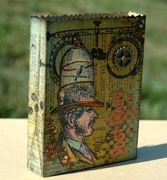 """The In the Bag Tim Holtz Sizzix die. """"a really cute little paper bag that is the perfect size to hold ATCs among other small things.  The finished size of this bag is 3x4 and approximately 3/4"""" deep.  The size is so stinkin' cute!"""""""