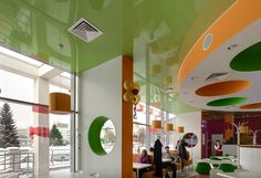 Green lacquer stretch ceiling in a kid's cafe. Green is the color of life. That's why this ceiling will enlighten the entire premise.