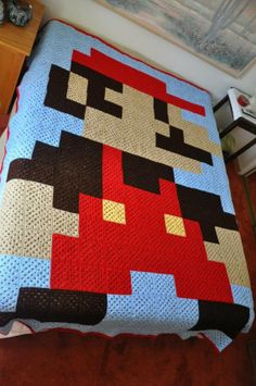 I literally just told my mom 15 mins ago that I should make a pacman granny square blanket when I saw this.