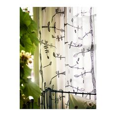 hand-drawn birdies and leaves curtains.
