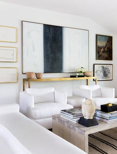 Neutral living space that still incorporates art with lots of character Design by Laura Singleton