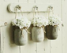 ***THIS IS FOR A SET OF 3 MASON JAR WALL DECOR....  ~~~~~Hydrangeas are now available and can with added to your order from pull down menu. They are a cream/white with green little centers.  The flowers have soft petite petals.....   These boards are  perfectly imperfect  with lots of rustic character. Some may have knot holes, cracks, holes etc.... No 2 are them same.  These are stained in a special custom stain color. Please note that no two boards will stain the same... Some may be sl...