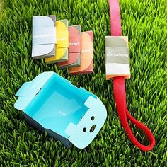 The Slurpabowl is a cute, recyclable, portable drinking bowl that folds up and attaches to the leash. | 28 Ingenious Things For Your Dog You Had No Idea You Needed.......some of these make me chuckle.